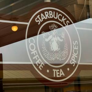 Starbucks sign on glass window, Pike Place Market, Seattle, Washington State, USA