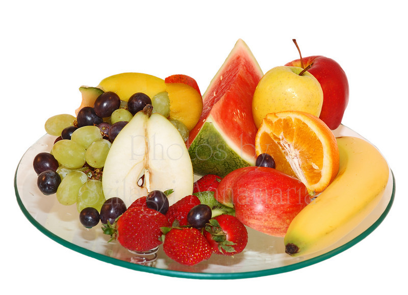 Selection of fruit on glass plate with isolated background