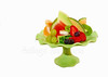 Fresh fruit selection on plate with isolated background