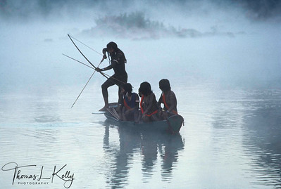 A Kayapo fishermen on a misty morning. Xingu, Gorotire Kayapo Reserve, Brazilian Amazon.