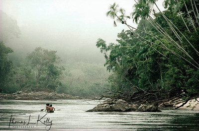 Mukuna people referred to as the Water People paddle the Apaporis River in the Vaupes area. Makuna, Eastern Colombia Amazon, Vaupes region.
