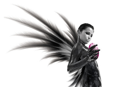 Sexy dark angel with the magic sphere. Isolated on white.