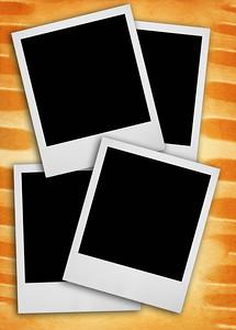 blank photo frames against rough grunge background