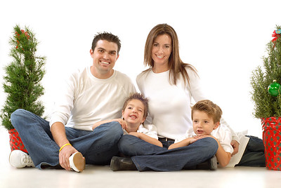 Happy young family posing for their cheerful holiday portrait