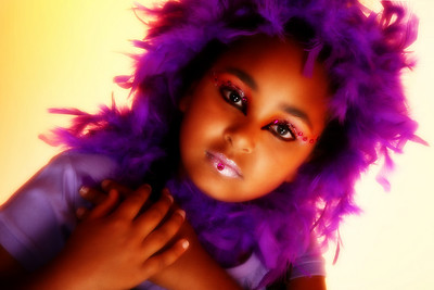 Beautiful ten year old african american girl in artsitic make-up.