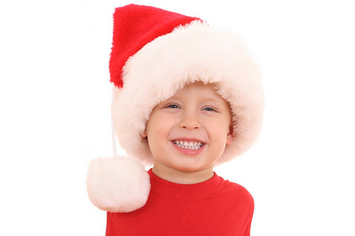 adorable 3-4 years old boy in red Christmas hat isolated on white
