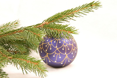Christmas decoration  - conifer decorated with blue bulb isolated on white