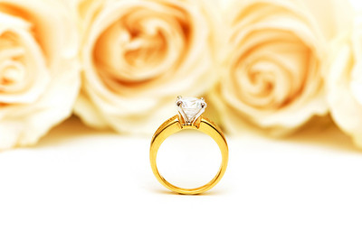 Roses and wedding ring isolated on the white