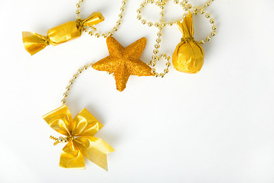Gold christmas garland with bow; star and sweets on chain