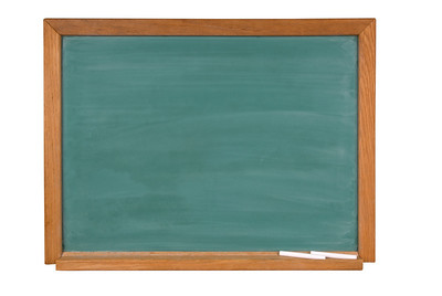 Blank green chaklboard with chalk in a wood frame isolated over white with a clipping path