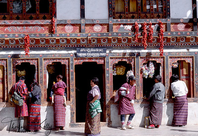 The national dress for Bhutanese men is the gho, a knee-length robe tied at the waist by a cloth belt known as the kera. Women wear an ankle-length dress, the kira, which is clipped at one shoulder and tied at the waist. An accompaniment to the kira is a long-sleeved blouse, the toego, which is worn underneath the outer layer. Social status and class determine the texture, colours, and decorations that embellish the garments. Differently coloured scarves and shawls are important indicators of social standing, as Bhutan has traditionally been a feudal society. Jewellery is mostly worn by women, especially during religious festivals (tsechus) and public gatherings. To strengthen Bhutan's identity as an independent country, Bhutanese law requires all Bhutanese citizens to wear the national dress in public areas and as formal wear.