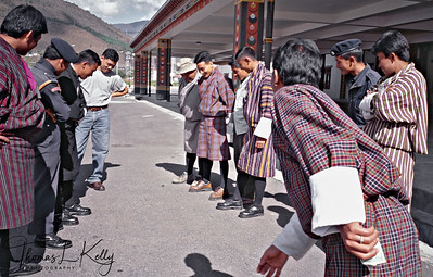 In betwen the arrival of interenational flights, Bhutanese custom officers play a coin tossing game.
