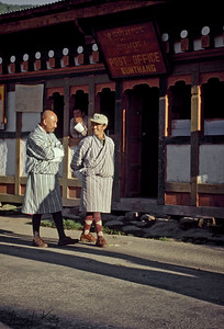 Bhutanese men wearing traditional dress. The national dress for Bhutanese men is the gho, a knee-length robe tied at the waist by a cloth belt known as the kera.