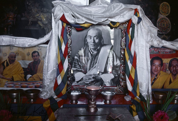 Memorial photo of the present King's father, Jigme Wangchuck, who became the second hereditary king of Bhutan. He ruled during the great depression and WWII, but these catastrophic world events did not affect Bhutan because of its barter economy and isolation. His Majesty Jigme Wangchuck refined the adminisrtaive and taxation systems and brought the entire country under his direct control. King Jigme Wangchuck died in 1952 and was succeeded by his son, Jigme Dorji Wangchuck, who had been educated in India and England and spoke fluent Tibetan, English and Hindi. His picture is seen to the left and right of his father. He constituted the National Assembly in 1953 and abolished serfdom in 1956, reorganized land holdings, created the Royal Bhutan Army (RBA) and police force, and established the High Court. To improve relations with India he invited Pandit Jawaharlal Nehru and his daughter, Indira Gandhi, to visit Bhutan in 1958. However, as he lad Bhutan into the modern world, he emphasized the need to preserve Bhutanese culture and tradition.