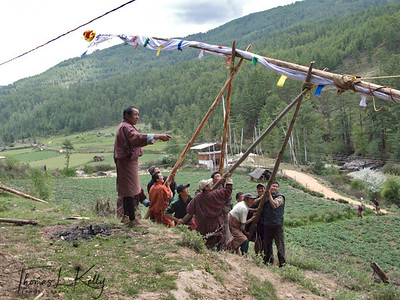 Erecting Prayer flags. Taang Valley.