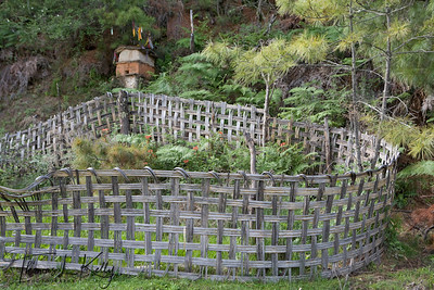 A shrine to a local water god and fence enclosure near. Outskirst of Trongsa.