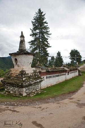 Entrance chorten and mani wall to Gangtey village. Phobjika, Bhutan.