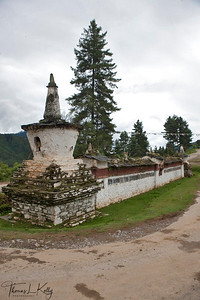 Entrance chorten and mani wall to Gangtey village. Phobjika, Bhutan.