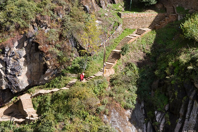 Buddhist monks walking uphill to Taktsang Monastery.  Paro Valley, Bhutan.