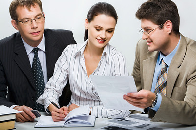Confident boss is showing research results to his team in the office
