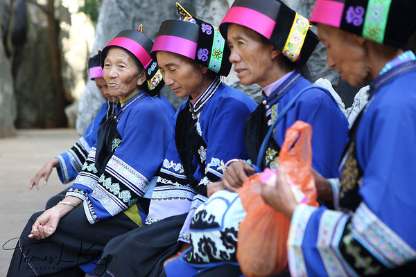 Chinese woman in their traditional attire at Shilin Stone Forest. Yunnan Province, South West China.