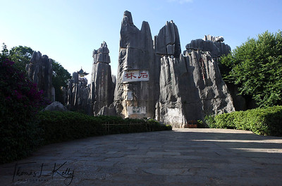 Main entrance to the Shilin Stone Forest. Shilin (Stone Forest) is a notable set of karst formations in Shilin Yi Autonomous County, in the Yunnan province of southwest China, approximately 85 km from the city of Kunming.  Yunnan Province, South West China.
