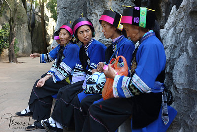 Chinese woman in their traditional attire at Shilin Stone Forest Yunnan Province, South West China.