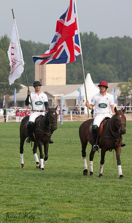 British Polo Player fluttering their National flag prior to Match. National Stadium (Bird's Nest). China.