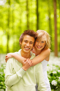 A portrait of a sweet couple in love. Outdoors enjoying the spring and each others company. This collections unique keyword is: younglove123