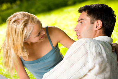 Young happy attractive smiling couple together outdoors