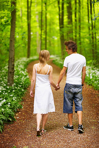 A portrait of a sweet couple in love. A walk in the forest,  enjoying the spring and each others company. This collections unique keyword is: younglove123