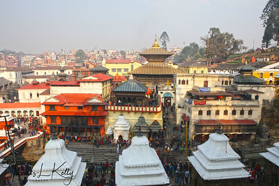 Pashupatinath temple during Maha Shiva Ratri.  Shiva Ratri is a twenty-four-hour adoration of Lord Shiva the God of destruction in the Hindu triad and one of the valley's most revered deities. The golden-tiered Pashupatinath temple is dedicated to Shiva as Lord of animals and Nepal's patron God. The entire area has numerous shrine, bathing and cremation ghats, and scattered stone sculptures including the devoutly worshiped Shiva lingam. Throughout the year, Pashupatinath attracts sadhus (ascetics), mendicants, and other devotees, but on festival days thousands of pilgrims arrive to take a purifying bath in the sacred Bagmati river and then pay homage to the sacred lingam inside th main Pashupatinath temple. Throughout the days and well into the night, one can witness ash-covered sadhus, foreheads painted with tridents, emulating Lord Shiva by performing various yoga feats. Mahashiva Ratri is also a time for many Shivite followers to debate the Hindu texts. Kathmandu, Nepal.  Kathmandu, Nepal.