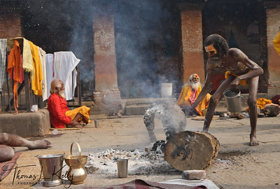 During the time of festival, a Sadhu prepares a dhuni.  Pashupatinath temple, Kathmandu, Nepal.