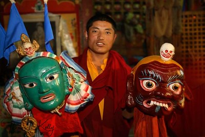 Monk carries mask to the mask dancers. Chiwong Monastery, Solu Khumbu, Nepal.