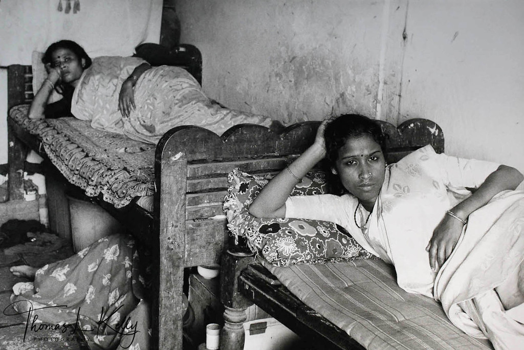 WOMEN OF WELCOME BROTHEL<br /> Conditions for prostitutes are marginally better in some brothels, such as the<br /> 'welcome brothels' of Mumbai, which serve middle-class clients. Here, women are<br /> allowed some time for recreation, and are sometimes permitted to leave the brothels<br /> to get medical care of visit their families, if they have one. Mumbai sex workers relax<br /> in the afternoon before work<br /> Mumbai, India.