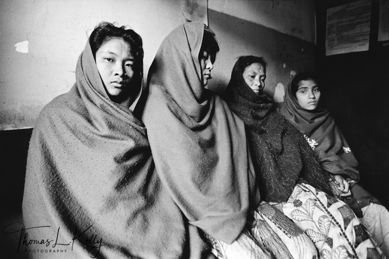 TRANSPORTATION SECTOR<br /> In South Asia, perhaps more women then men are the 'mules' that transport girls<br /> across national borders. The three women on the left were arrested in 1999 for the<br /> alleged trafficking of Nepali girls to Mumbai.<br /> Hanuman Dhoka jail, Kathmandu, Nepal.