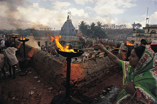 """31GODDESS YELLAMA<br /> Each year in January, thousands of low caste farmers pilgrimage to the temple of<br /> Goddess Yellama, patron deity of the downtrodden, hijras, and prostitutes. Saturated<br /> in turmeric dust, crowds of villagers circumambulate the temple shouting """"Udheyo!<br /> Udheyo! Rise Up to the Mother!""""<br /> Saundatti, Karnataka, India."""