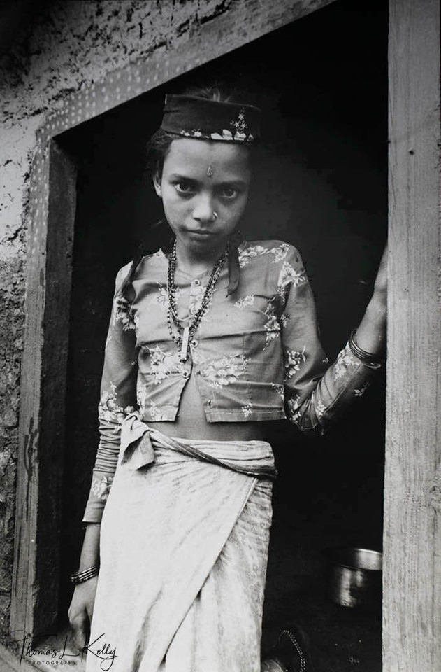 IN THE NAME OF GOD<br /> Young Deuki girls, forbidden to marry are dedicated at temples of the mother<br /> goddess throughout Far Western Nepal.