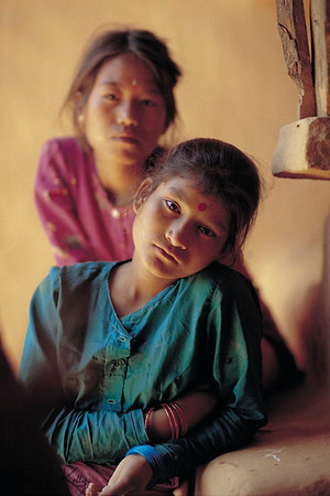 "Tamang girls have been victims of trafficking for generations. Today, many Tamang  girls are aware of the ""work"" they  will have to do when they go to Bombay. With the innate  optimism of youth, they  think that they can some day return with wealth. Sindupalchowk, Nepal."