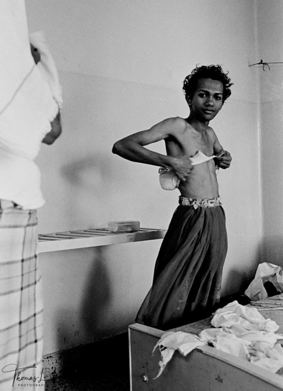 TRANSVESTITES <br /> Sahodaran worker of Prakriti Sahodaran, gets ready to go out for work at the annual Aravan festival which attracts trans-sexuals from all over the country.<br /> Chennai, Madras, South India.