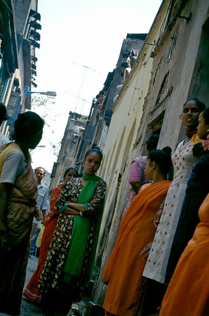 "RED-LIGHT AREA Prostitutes wait for clients in a narrow lane, ""middle-class"" red light district of Bow Bazaar area in north Calcutta. Calcutta, India."