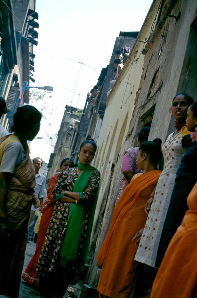 """RED-LIGHT AREA<br /> Prostitutes wait for clients in a narrow lane, """"middle-class"""" red light district of Bow Bazaar area in north Calcutta.<br /> Calcutta, India."""