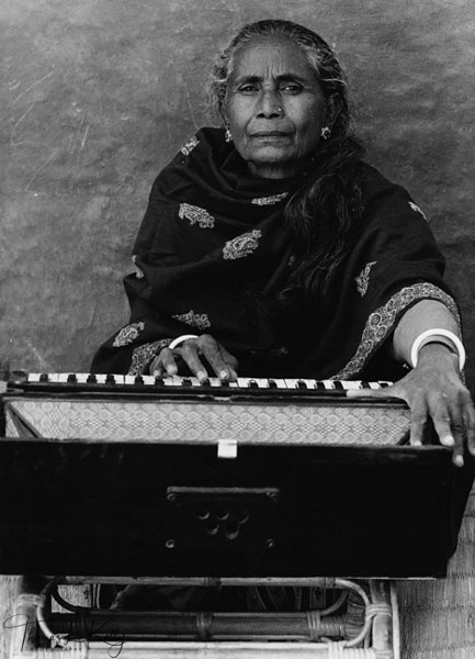 LAST PERFORMANCE<br /> The Badi were once a caste of itinerant performers who sang and danced in the<br /> palaces of minor South Asian nobility. Today many Badi, through not all, are<br /> reduced to prostitution. Tatalau, now 79, is among the last of the Bad who performed<br /> a s a classical singer and dancer. Says Tatalau, 'The girls today are like the wind.<br /> They do not have the patience and discipline necessary for classical music. That is<br /> why they have to prostitute themselves.'<br /> Midwestern Region, Nepal