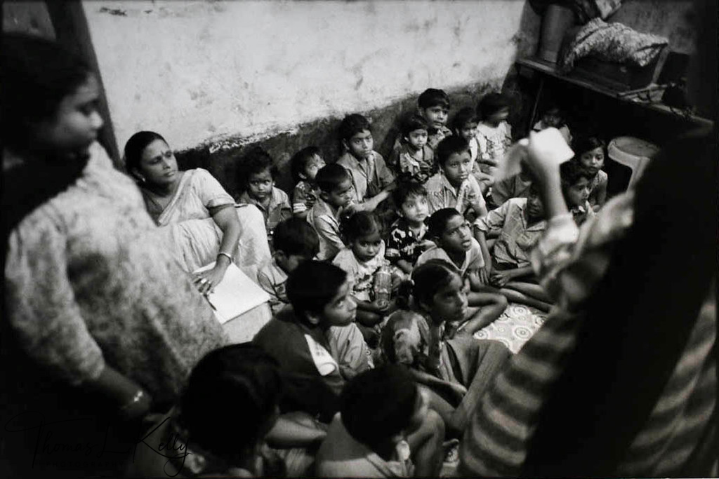 FROM EXPLOITED TO EMPOWERED<br /> Women from the Durbar Mahila Samanwaya Committee, a collective of sex workers in Bengal, volunteer their time to give non-formal education classes to young children at risk.<br /> Calcutta, India