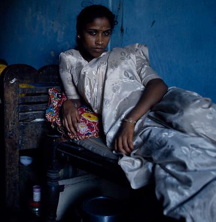GEETANJALI Mumbai sex worker Geetanjali relaxes in the afternoon before work. Kamathipura, Mumbai, India.