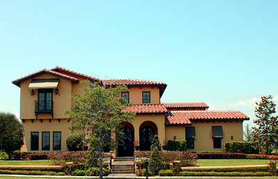 spanish style home with arches