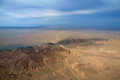 "Aerial view of dessicated land and mountain in Bayan-Olgii, which is a ""Kazakh province'. Mongolia"