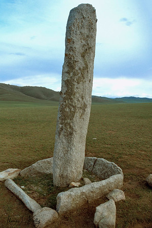 Khirigsuur or burial mound and Bronze Age megalith, 900 B.C. in Monkhe Tengri. Orkhan Valley, Central Mongolia.