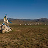 Sacred Oovo with the backdrop of Ger camp settlement. Monkhe Tingri, Mongolia.