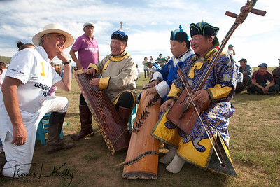 Christopher Giercke enjoys Mongol musicians. They play The Morin khuur (horse-head fiddle) and do humii throat singing. Monkhe Tingri, Mongolia.